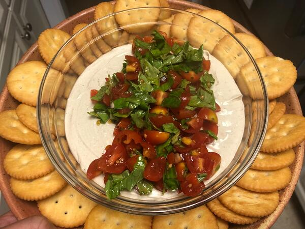 black garlic dip with tomatoes basil