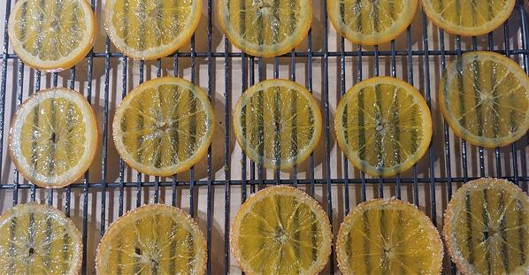 candied oranges on rack