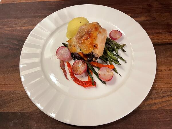 chicken vegetables and potatoes plated
