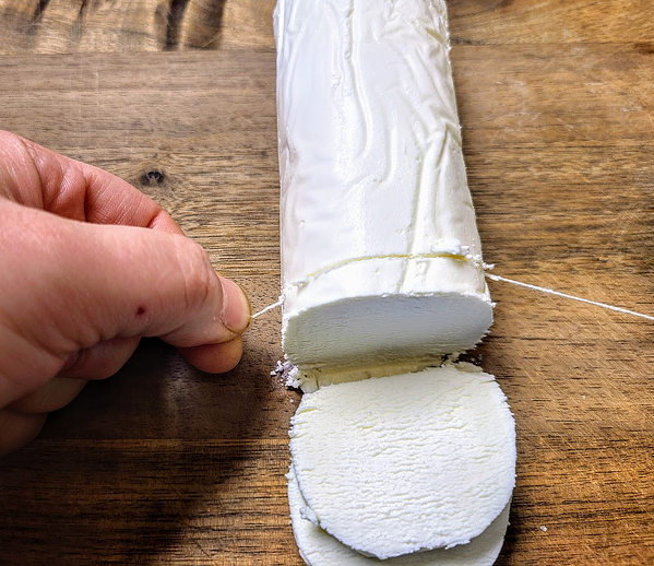 cutting goat cheese