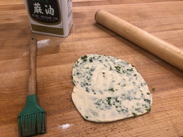 dough rolled third time with scallions