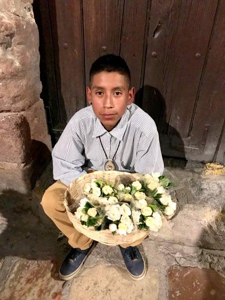 kid selling gardenias