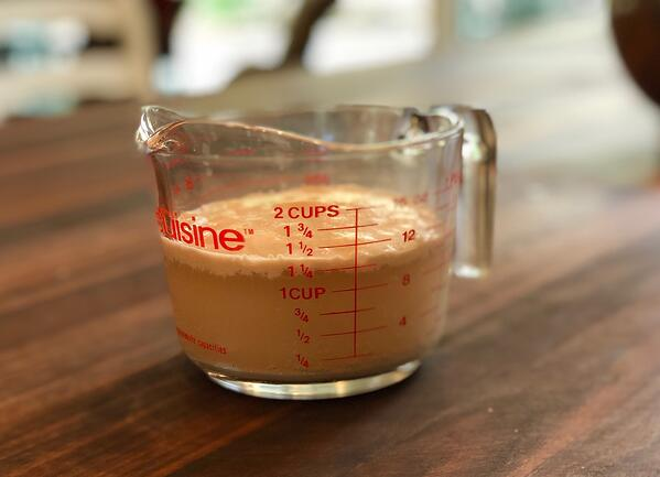 measuring cup with yeast