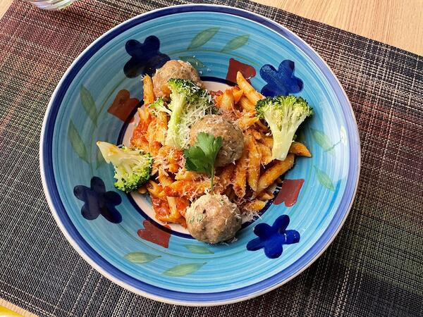 plated meatballs with broccoli and pasta