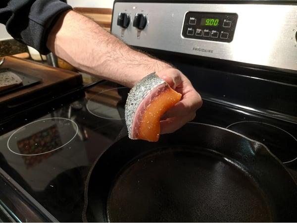 salmon going into pan