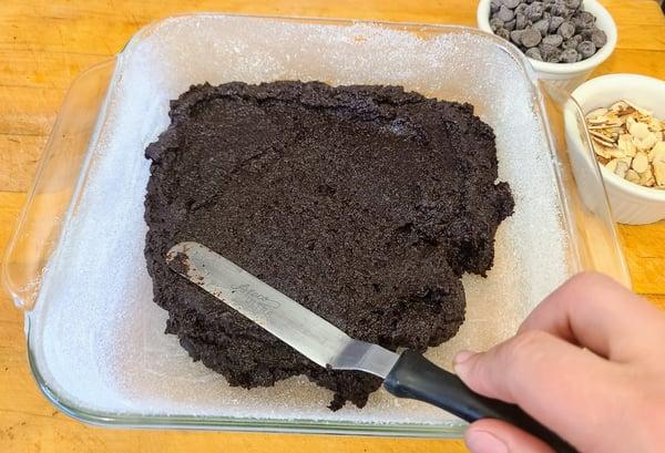 spreading brownie batter