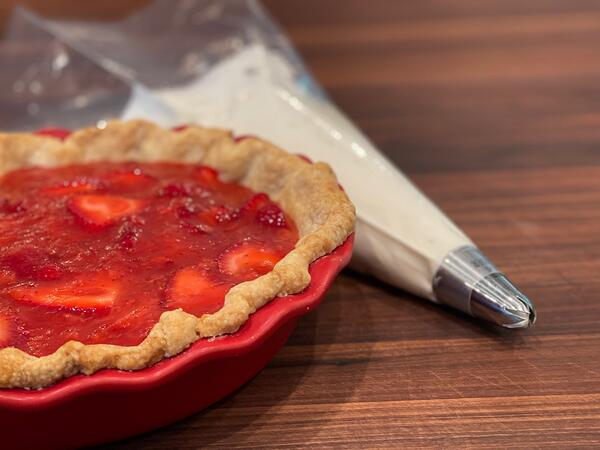 strawberry pie with piping bag