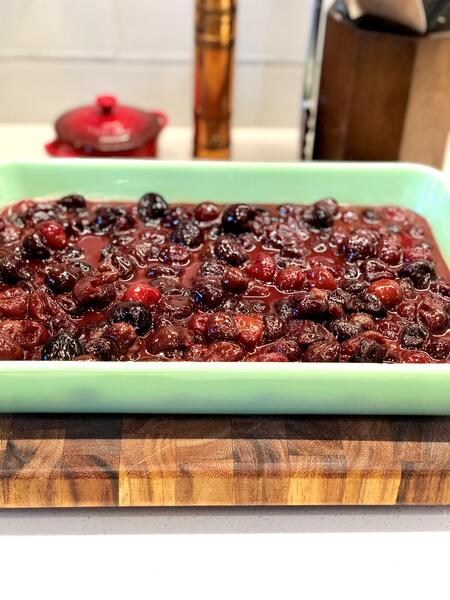 cherries in buttered baking dish