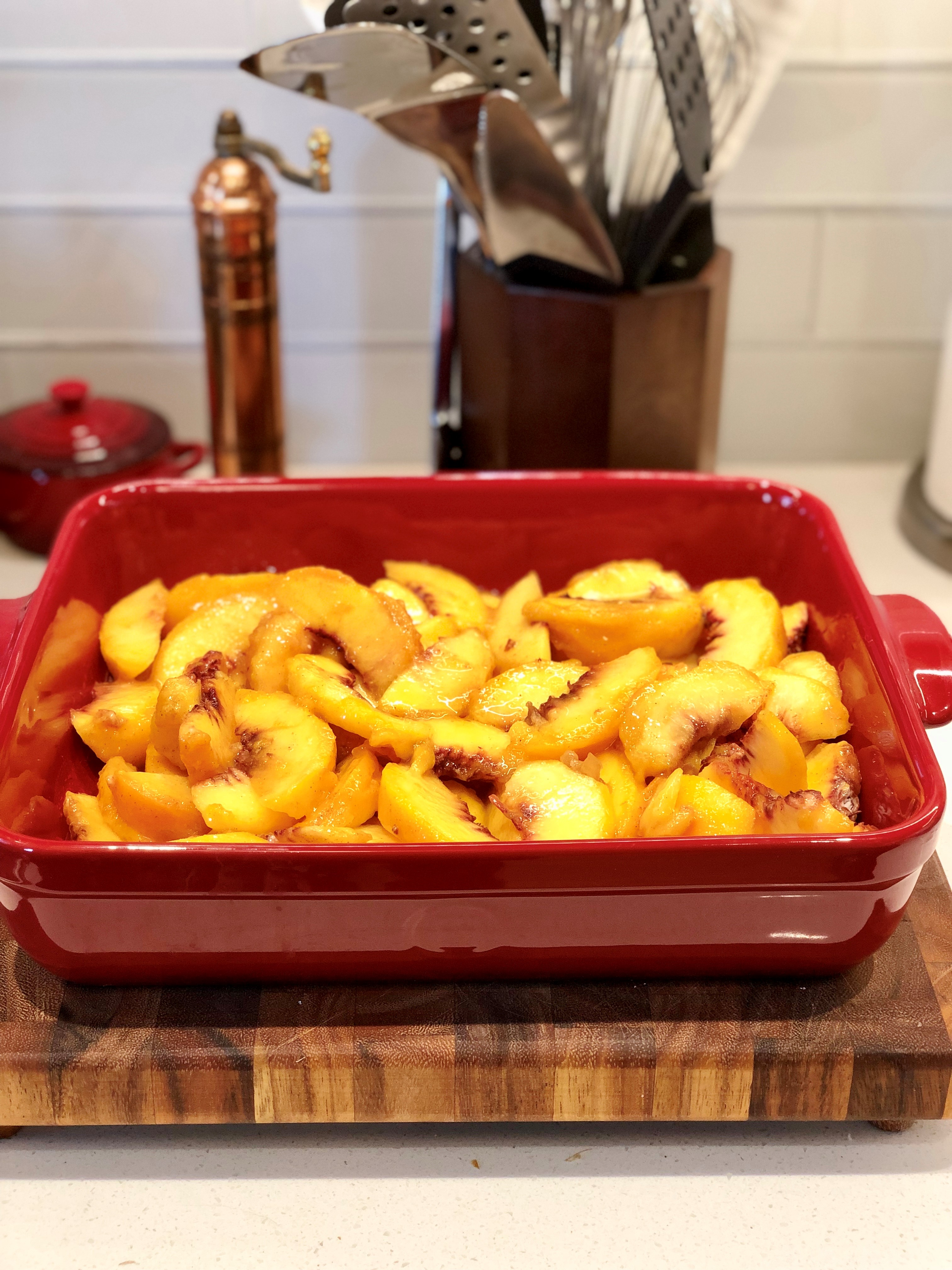 peaches in buttered baking dish